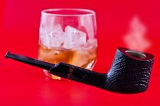 Pipe And Whiskey With Ice Stock Image