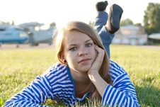 Free Beautiful Girl In The Shirt On The Grass Royalty Free Stock Image - 21998936