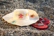 Free Hat And Flip-flops On The Stones Royalty Free Stock Photo - 21999135