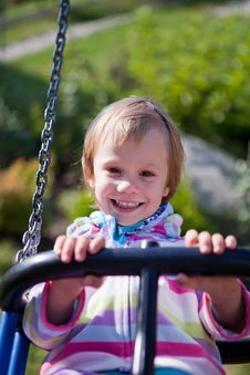 Little Girl On The Swing. Stock Images