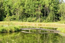 Free Wooden Bridge Over Pond - Horizontal Royalty Free Stock Photo - 220985