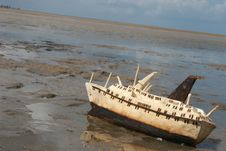 Free Wood Carving Of A Ship Stranded On The Beach Stock Photo - 221300