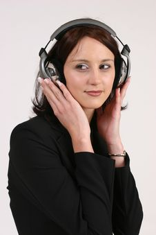 Businesswoman Listening To Her Favorite Music