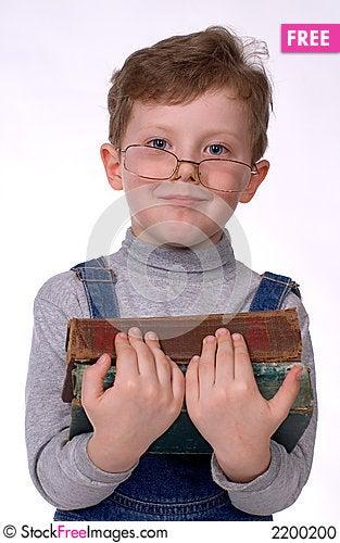 The boy with books smiles Stock Photo