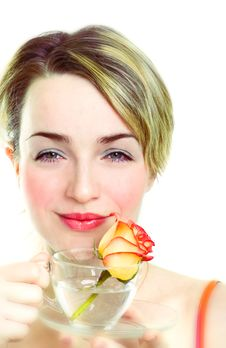 Girl With Rose In The Cup Royalty Free Stock Photography