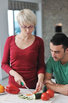 Free Young Couple Have Fun In Modern Kitchen Royalty Free Stock Photo - 22004025