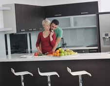 Free Young Couple Have Fun In Modern Kitchen Stock Photo - 22004100