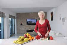 Free Happy Blonde  Woman Prepare Food In  The Kitchen Royalty Free Stock Image - 22004366