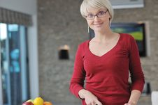 Free Happy Blonde  Woman Prepare Food In  The Kitchen Stock Image - 22004371