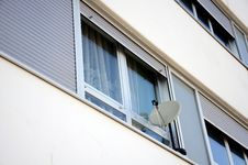 Free Satellite Dish At The Window Royalty Free Stock Image - 22005606