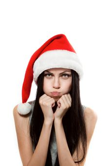 Girl Is Offended In Santa Claus Hat Royalty Free Stock Photos