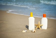Free Suntan Lotion Flacons On The Beach With Copy Space Stock Photo - 22017940