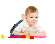 Free Cute Little Child Is Playing With Toys While Lying Stock Images - 22024994