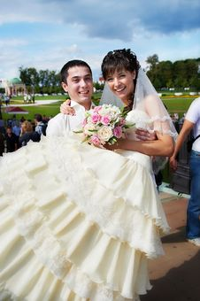 Groom Carries His Bride In Arms Stock Photography