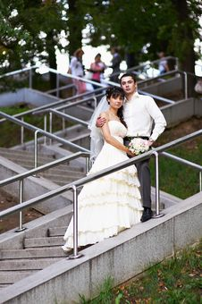 Free Bride And Groom On Stairs Royalty Free Stock Photography - 22025347