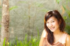 Free Pretty  Young Woman Smiling With Braces Royalty Free Stock Image - 22025496