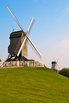 Two Wind Mill And Green Lawn At Brugge - Belgium Royalty Free Stock Photo