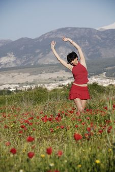 Free A Girl Dressed In Red In A Field Of Poppies Stock Image - 22028091
