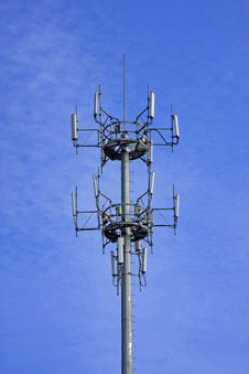 Signal Tower Of Mobile Phone On Blue Sky Stock Image
