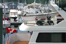 Free Two Scooters On A Yacht, Vancouver BC. Canada. Royalty Free Stock Photo - 22032525