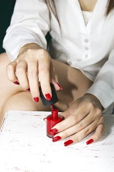 Woman S Hand And Red Lacquer Royalty Free Stock Photo