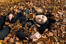 Free Woman Lying In Fallen Leaves Royalty Free Stock Photos - 22047288