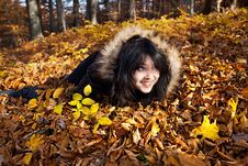 Free Woman Lying In Fallen Leaves Royalty Free Stock Photos - 22048538