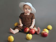 Free The Child With Apples On A Gray Background Royalty Free Stock Image - 22059106