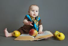 Free The Child With The Book And Apples Royalty Free Stock Images - 22059109