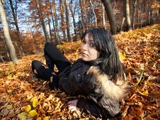 Free Woman Lying In Fallen Leaves Royalty Free Stock Image - 22061606