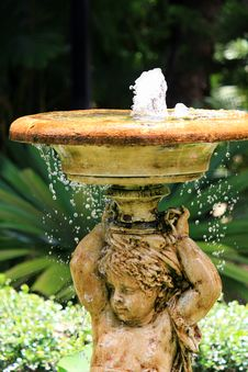Bubbling Angel Sculpture Fountain In The Garden Stock Images