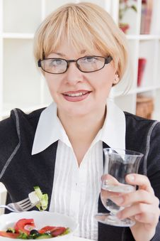 Adult Blonde Woman In Glasses Eats Salad Stock Photos