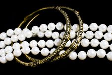 Free Brass Bracelets And Fashion Pearls On Black Stock Photo - 22065200