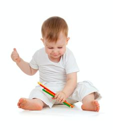 Free Funny Baby Boy Drawing With Color Pencils Stock Images - 22065684