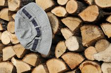 Free Stack Of Firewood And Hat Royalty Free Stock Image - 22068216