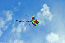 Free Flying Kite In The Blue Sky Stock Photo - 22080330