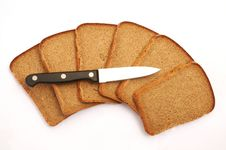 Free Cut Bread With A Knife Stock Photos - 22080933