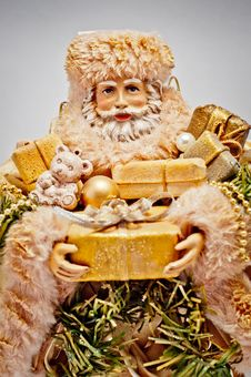 Santa Claus With Golden Gifts Stock Photo