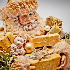 Santa Claus With Golden Gifts Royalty Free Stock Images