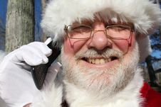 Free Santa Talking On His Cell Phone Royalty Free Stock Images - 22082749