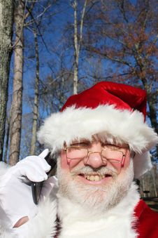 Free Santa Talking On His Cell Phone 2 Stock Photo - 22082750