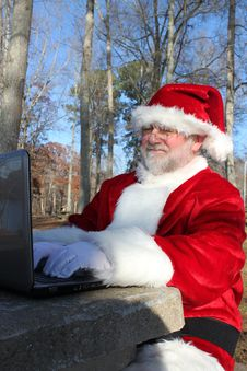 Free Santa With His Laptop Stock Images - 22082754