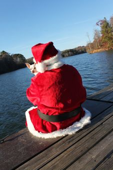 Free Santa On The Dock With His Dog Stock Image - 22082871