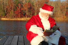 Free Santa Reading On The Dock Stock Images - 22082944