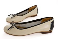 Free Pair Of Beige Female Shoes With Black Bow Royalty Free Stock Image - 22087286