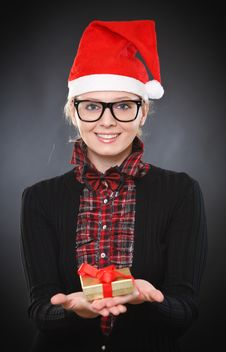 Free Blonde Young Woman Gives Gift Stock Images - 22090744