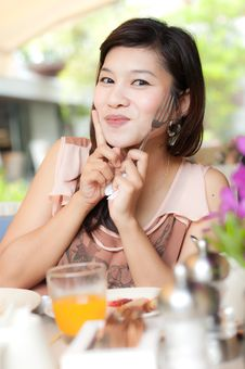 Free Beautiful Girl Holding Fork And Enjoy Her Food Royalty Free Stock Images - 22095379