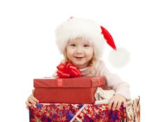 Happy Child In Christmas Santa S Hats With Gifts Royalty Free Stock Photo