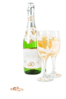 Wedding Rings, Glass And Bottle Of Champagne Royalty Free Stock Image