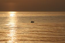 Small Boat In The First Sun Ra Royalty Free Stock Photo
